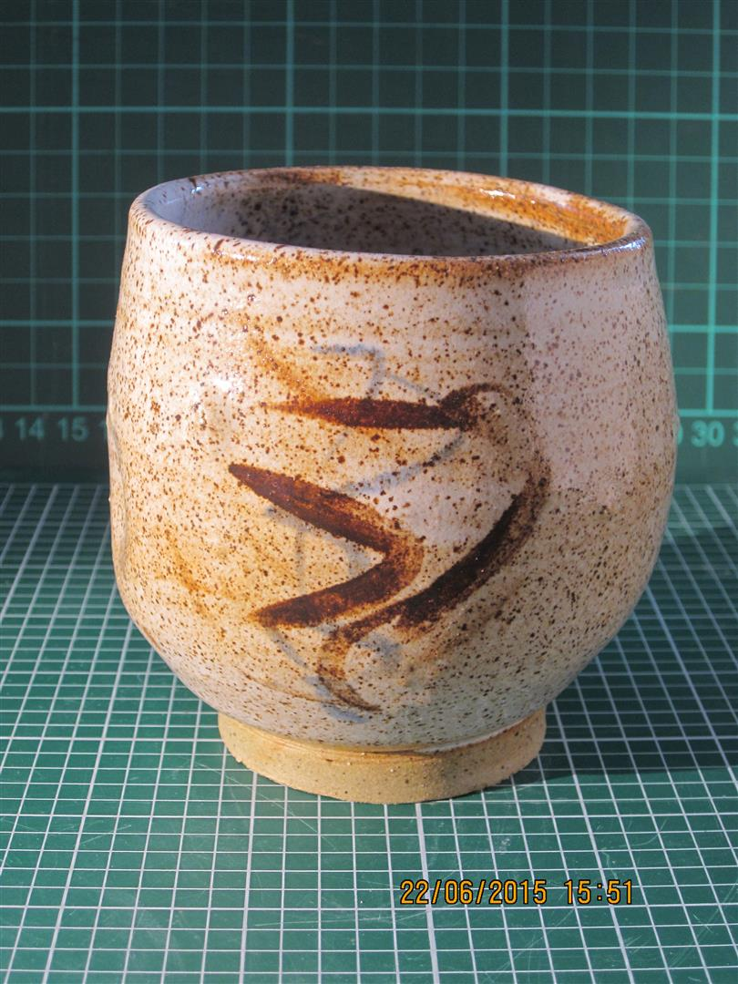 Tea bowl in speckled stoneware with tin glaze